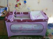 Продам манеж-кроватку красно-розового цвета